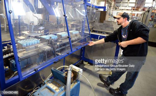 Allen Prupp keeps the canning line moving at Oskar Blues Brewery in Longmont Colorado on Friday as the brewery canned water not beer for Hurricane...