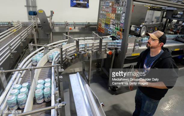 Allen Prupp monitors the canning line at Oskar Blues Brewery in Longmont Colorado on Friday as the brewery canned water not beer for Hurricane...