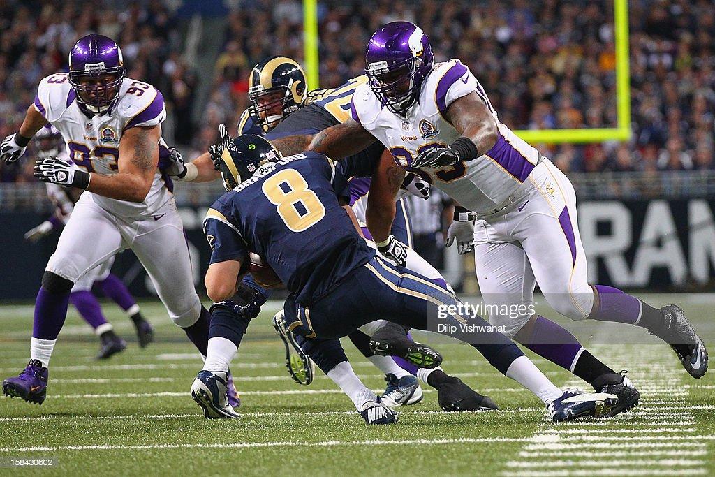 Allen Reisner #83 of the Minnesota Vikings sacks Sam Bradford #8 of the St. Louis Rams at the Edward Jones Dome on December 16, 2012 in St. Louis, Missouri.