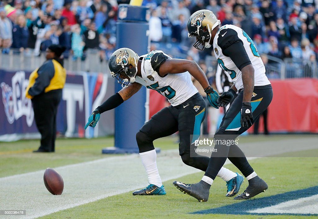 Allen Robinson #15 and Julius Thomas #80 of the Jacksonville Jaguars celebrate after scoring a touchdown during the game against the Tennessee Titans at Nissan Stadium on December 6, 2015 in Nashville, Tennessee.
