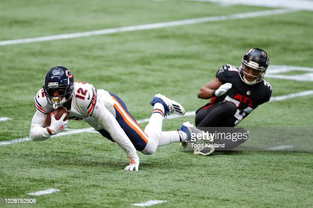 Allen Robinson II of the Chicago Bears makes the reception and is brought down by Darqueze Dennard of the Atlanta Falcons during the second quarter...