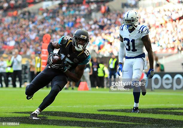 Allen Robinson of Jacksonville scores a touchdown during the NFL International Series match between Indianapolis Colts and Jacksonville Jaguars at...