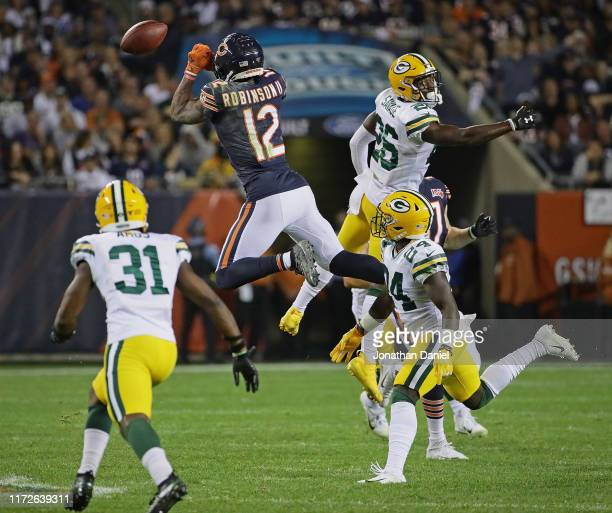 Allen Robinson of the Chicago Bears can't make a catch in traffic surrounded by Adrian Amos Darnell Savage and Raven Greene of the Green Bay Packers...