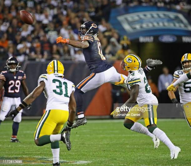 Allen Robinson of the Chicago Bears can't make a catch in traffic surrounded by Adrian Amos and Darnell Savage of the Green Bay Packers at Soldier...
