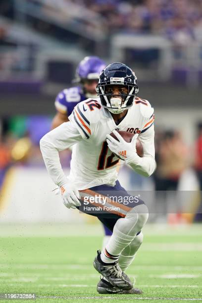 Allen Robinson of the Chicago Bears carries the ball against the Minnesota Vikings during the game at U.S. Bank Stadium on December 29, 2019 in...
