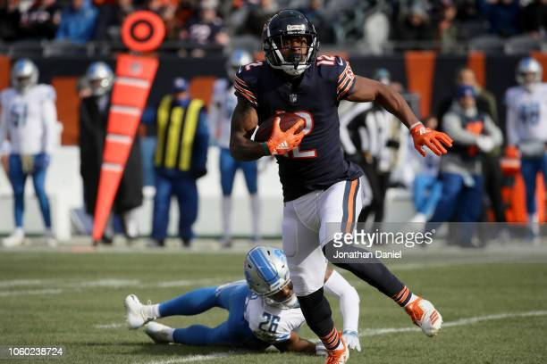 Allen Robinson of the Chicago Bears carries the football past DeShawn Shead of the Detroit Lions in the first quarter at Soldier Field on November...