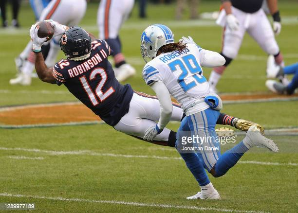 Allen Robinson of the Chicago Bears catches a pass in front of Darryl Roberts of the Detroit Lions at Soldier Field on December 06, 2020 in Chicago,...