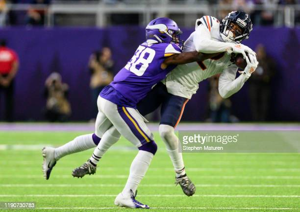 Allen Robinson of the Chicago Bears is tackled with the ball by Kris Boyd of the Minnesota Vikings in the third quarter of the game at U.S. Bank...