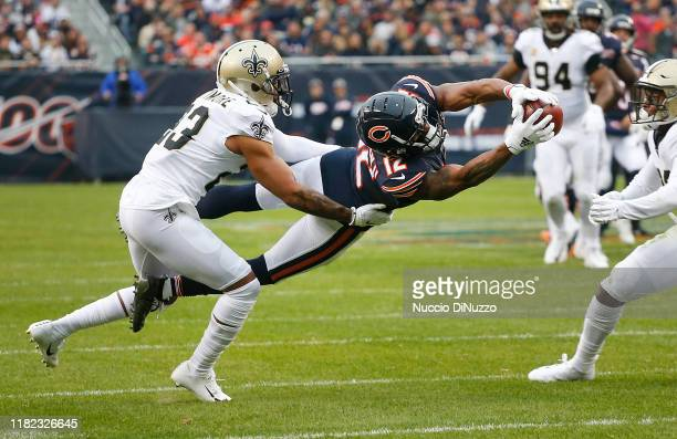 Allen Robinson of the Chicago Bears is unable to hold on to to a pass under pressure from Marshon Lattimore of the New Orleans Saints during the...