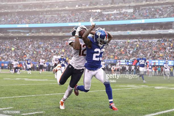 Allen Robinson of the Chicago Bears makes a catch during the second quarter while defended by B.W. Webb of the New York Giants at MetLife Stadium on...