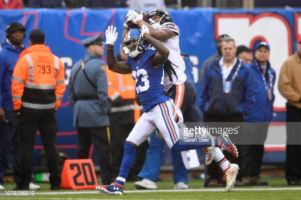 Allen Robinson of the Chicago Bears makes a catch while defended by B.W. Webb of the New York Giants at MetLife Stadium on December 02, 2018 in East...