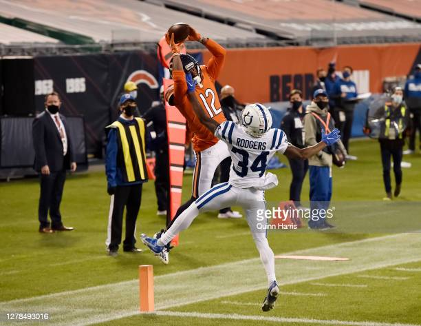 Allen Robinson of the Chicago Bears scores a touchdown in the fourth quarter against Isaiah Rodgers of the Indianapolis Colts at Soldier Field on...
