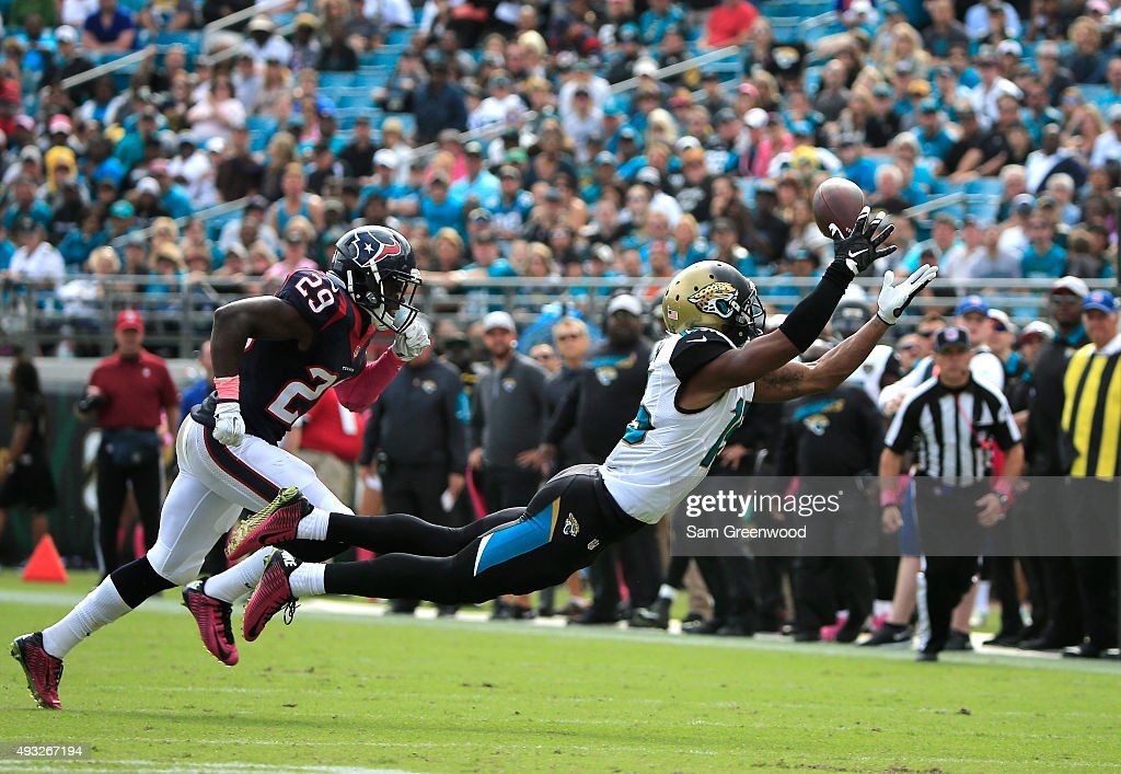 Allen Robinson #15 of the Jacksonville Jaguars attempts a reception against Andre Hal #29 of the Houston Texans during the game at EverBank Field on October 18, 2015 in Jacksonville, Florida.