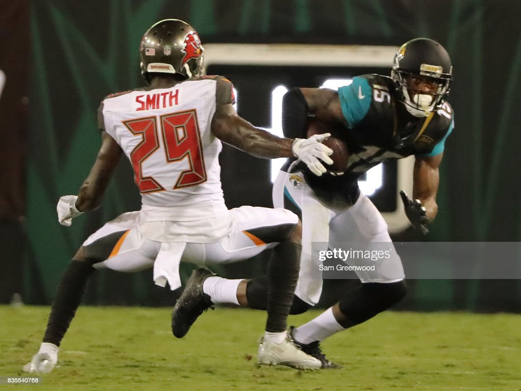 Allen Robinson #15 of the Jacksonville Jaguars attempts to run past Ryan Smith #29 of the Tampa Bay Buccaneers during a preseason game at EverBank Field on August 17, 2017 in Jacksonville, Florida.