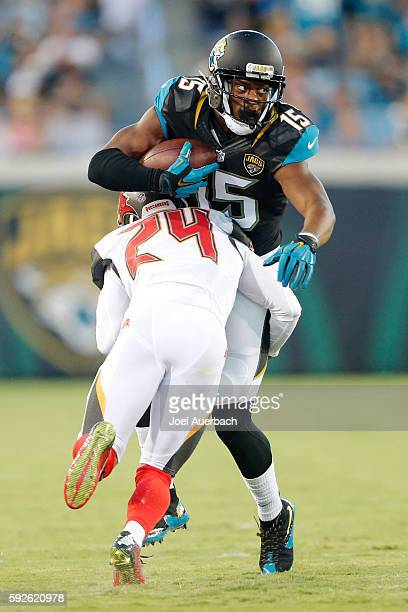 Allen Robinson of the Jacksonville Jaguars is tackled by Brent Grimes of the Tampa Bay Buccaneers as he runs with the ball during a preseason game on...