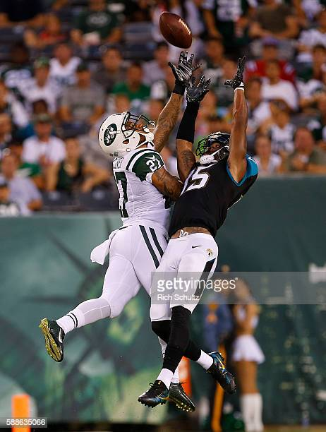 Allen Robinson of the Jacksonville Jaguars makes a catch as Dee Millner of the New York Jets defends during the first quarter of an NFL preseason...
