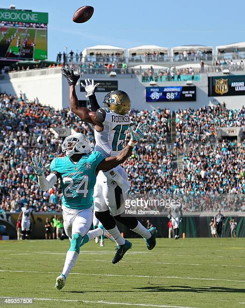 Allen Robinson of the Jacksonville Jaguars makes a catch over Brice McCain of the Miami Dolphins during a game at EverBank Field on September 20 2015...