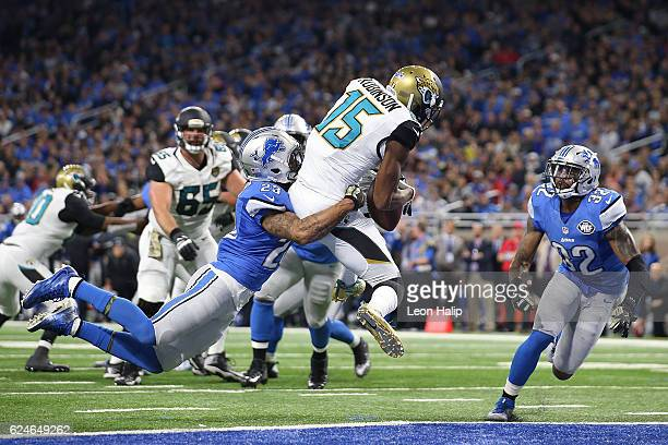 Allen Robinson of the Jacksonville Jaguars scores a touchdown against Darius Slay of the Detroit Lions and Tavon Wilson during second quarter action...