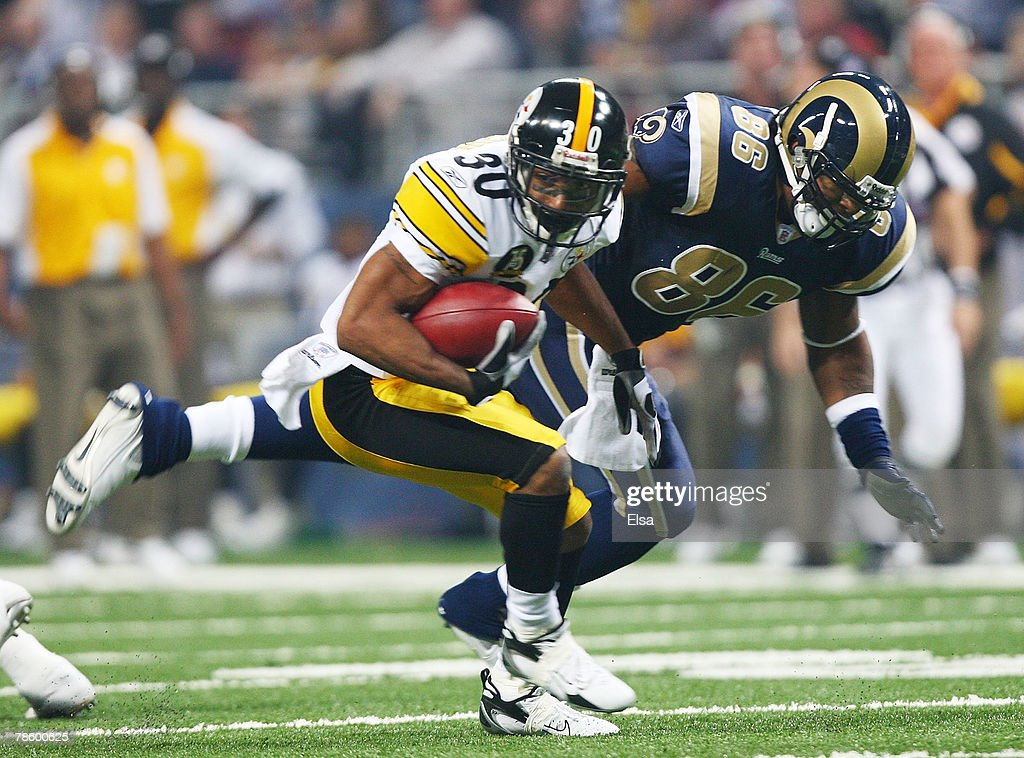 Allen Rossum #30 of the Pittsburgh Steelers carries the ball as Dominique Byrd #86 of the St. Louis Rams defends on December 20, 2007 at Edward Jones Dome in St. Louis, Missouri.