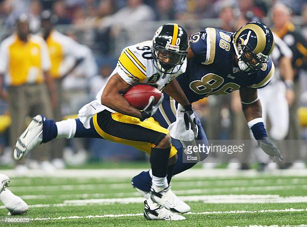 Allen Rossum of the Pittsburgh Steelers carries the ball as Dominique Byrd of the St Louis Rams defends on December 20 2007 at Edward Jones Dome in...