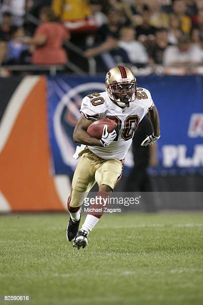 Allen Rossum of the San Francisco 49ers runs with the ball during the NFL game against the Chicago Bears at Soldier Field on August 21 2008 in...