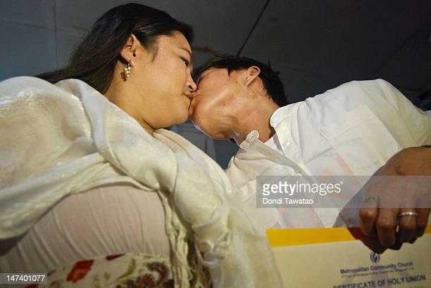 Allen Sales and Grace Morales kiss during a same sex marriage ceremony officiated by the Metropolitan Community Church a lesbian gay bisexual and...