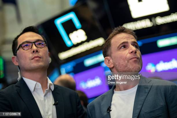 Allen Shim, chief financial officer of Slack; and Stewart Butterfield, co-founder and chief executive officer of Slack, wait to do a television...