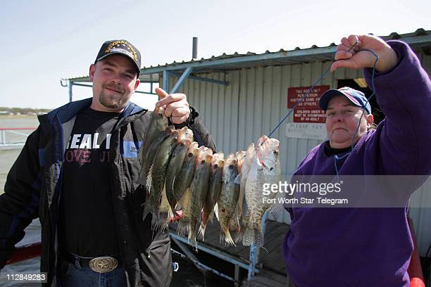 Allen Shultz left and Debbie Peanut Reynolds display the fish that Shultz caught Friday on Friday March 26 2010 at Peanut's Crappie House on Eddleman...