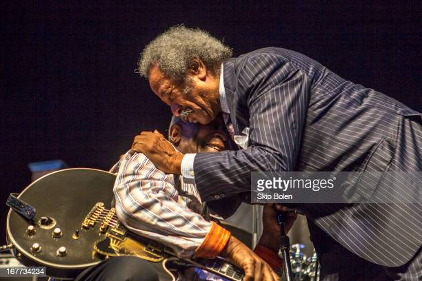 Allen Toussaint steps on stage to greet BB King during the 2013 New Orleans Jazz Heritage Music Festival at Fair Grounds Race Course on April 28 2013...
