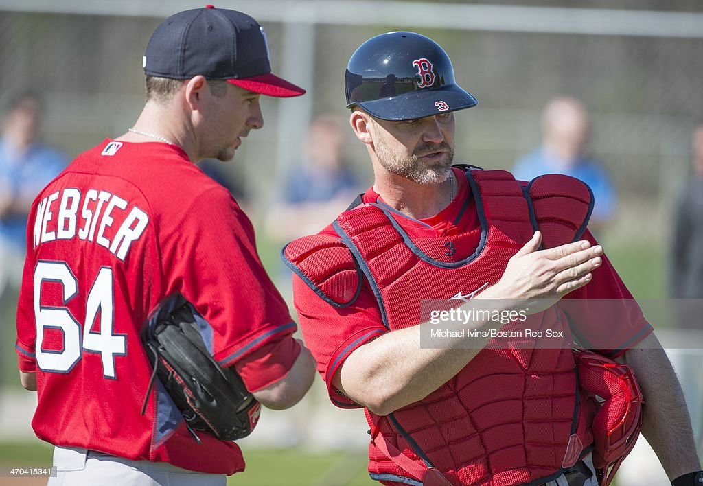 Allen Webster #64 of the Boston Red Sox listens to some guidance by David Ross #3 during a Spring Training workout at Fenway South on February 19, 2014 in Fort Myers, Florida.