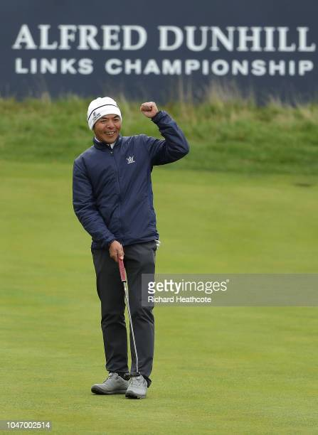 Allen Zhang celebrates after making a birdie putt on the 18th during day four of the 2018 Alfred Dunhill Links Championship at The Old Course on...