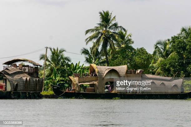 alleppey over river against trees and sky - kochi india stock pictures, royalty-free photos & images