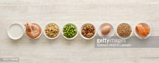 allergenic foods in bowls - eten stockfoto's en -beelden