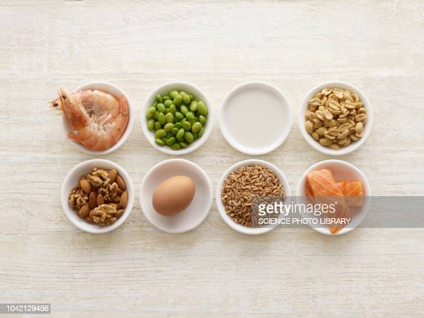 allergenic foods in bowls - nut food stock photos and pictures