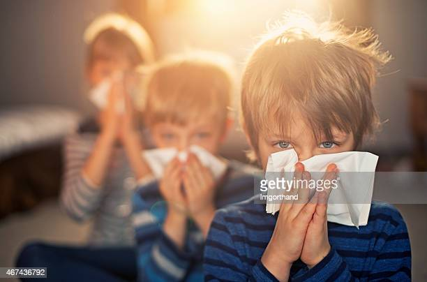 allergy generation - kids blowing noses - cold virus stock pictures, royalty-free photos & images