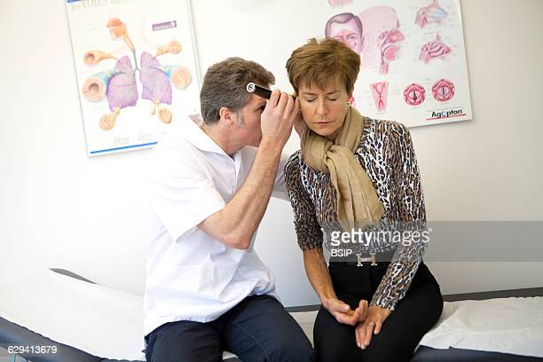 Allergy specialist practice in Geneva The allergy specialist checks a patient's ears