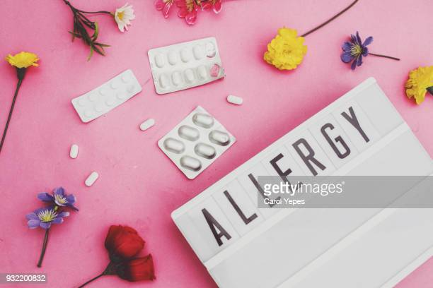 allergy text in lightbox with pills and flowers