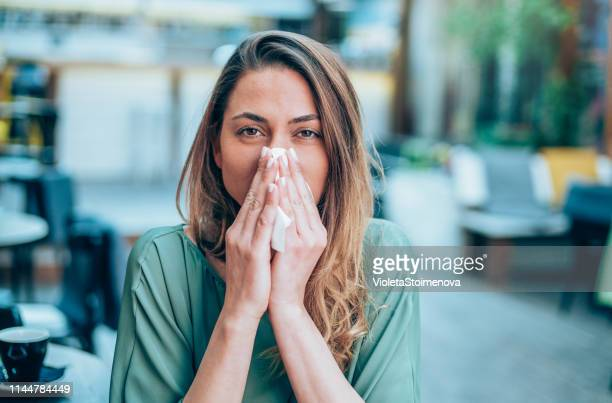 allergy woman blowing her nose - cold virus stock pictures, royalty-free photos & images