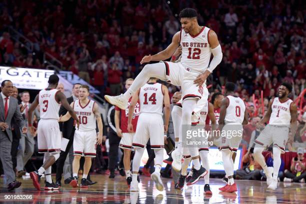 Allerik Freeman of the North Carolina State Wolfpack celebrates with teammates following a play against the Duke Blue Devils at PNC Arena on January...