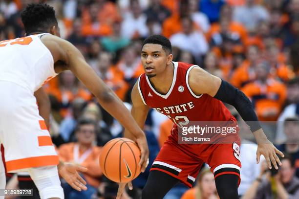 Allerik Freeman of the North Carolina State Wolfpack defends Tyus Battle of the Syracuse Orange during the second half at the Carrier Dome on...