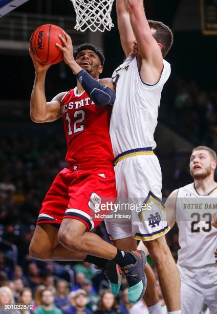 Allerik Freeman of the North Carolina State Wolfpack shoots the ball against John Mooney of the Notre Dame Fighting Irish at Purcell Pavilion on...