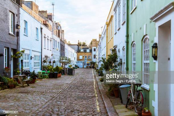 alley amidst buildings against sky - alley stock pictures, royalty-free photos & images