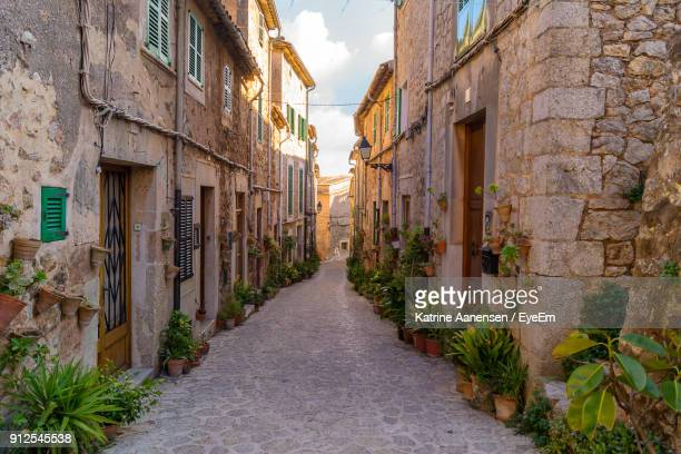 alley amidst buildings against sky - palma majorca stock photos and pictures