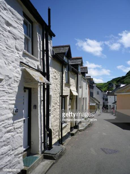 alley amidst buildings in city against sky - port isaac stock pictures, royalty-free photos & images
