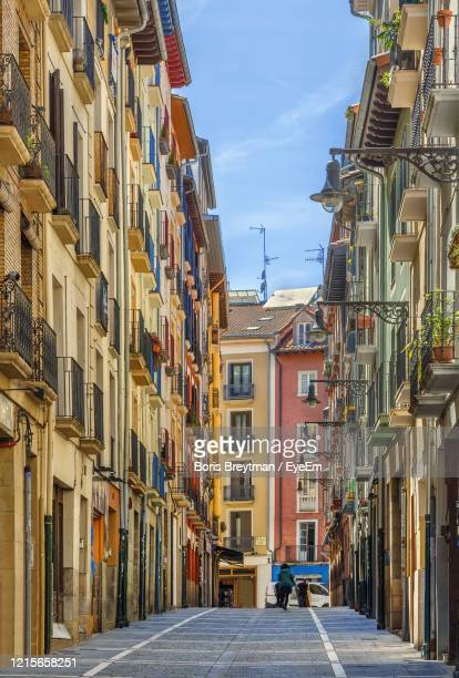 alley amidst buildings in city - pamplona stock pictures, royalty-free photos & images