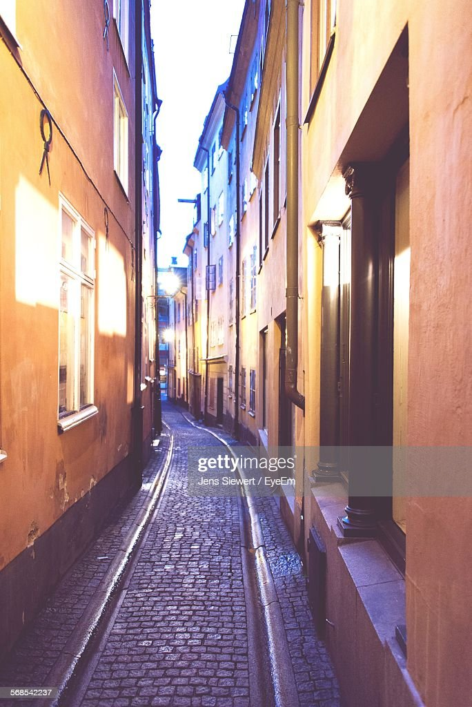 Alley Amidst Buildings In City : Stock Photo