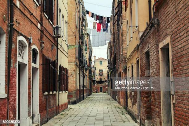 alley amidst buildings in city - old town stock pictures, royalty-free photos & images