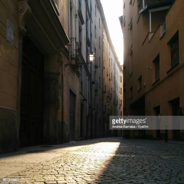 alley amidst buildings in city - narrow stock pictures, royalty-free photos & images
