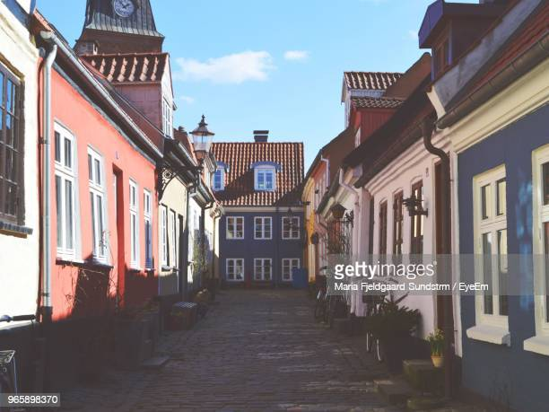 alley amidst buildings in city - aalborg stock pictures, royalty-free photos & images