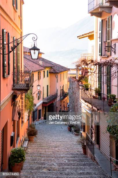 alley amidst buildings in town - bellagio stock pictures, royalty-free photos & images